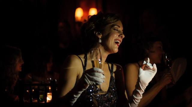 woman laughing with champagne victorian seance 2014.jpg